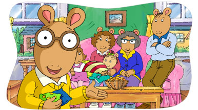 Arthur stands in front of his family holding bean bags.